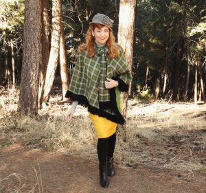 Green plaid poncho, yellow skirt and grey hat
