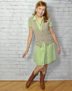 Vintage dress with sweater vest and cowboy boots